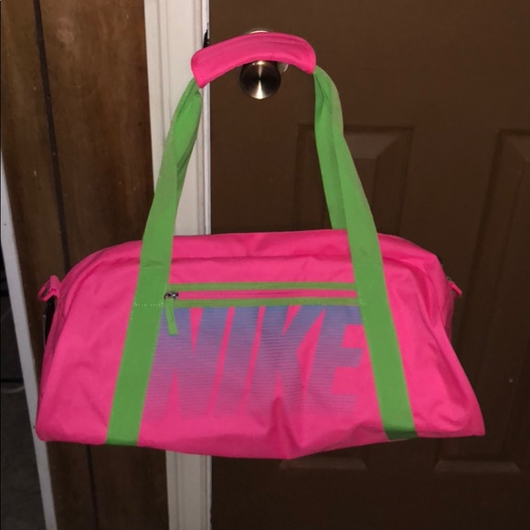 Pink and lime green Nike duffel bag. 9d6dfbed7